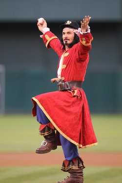 CM Throws First Pitch in As Cap.JPG